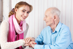 woman assisting old man